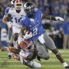 Sep 19, 2015; Lexington, KY, USA; Kentucky Wildcats wide receiver Dorian Baker (2) runs the ball against Florida Gators defensive back Marcus Maye (20) during the game at Commonwealth Stadium. Florida defeated Kentucky 14-9.  Mandatory Credit: Mark Zerof-USA TODAY Sports