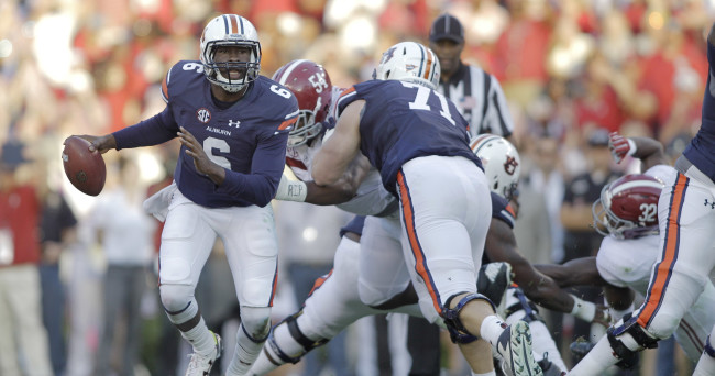 Nov 28, 2015; Auburn, AL, USA; Auburn Tigers quarterback Jeremy Johnson (6) carries against the Alabama Crimson Tide during the second quarter at Jordan Hare Stadium. Mandatory Credit: John Reed-USA TODAY Sports