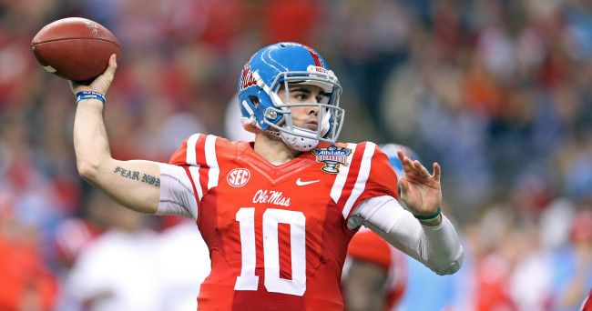 Jan 1, 2016; New Orleans, LA, USA; Mississippi Rebels quarterback Chad Kelly (10) looks to throw a pass against the Oklahoma State Cowboys in the second quarter of the 2016 Sugar Bowl at the Mercedes-Benz Superdome. Mandatory Credit: Chuck Cook-USA TODAY Sports