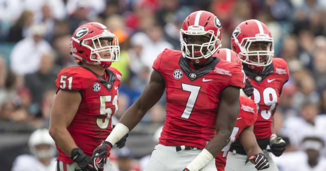 Jan 2, 2016; Jacksonville, FL, USA; Georgia Bulldogs linebacker Lorenzo Carter (7) celebrates after a tackle in the second quarter against the Penn State Nittany Lions at EverBank Field. Georgia defeated Penn State 24-17 to win the 2016 TaxSlayer Bowl. Mandatory Credit: Logan Bowles-USA TODAY Sports