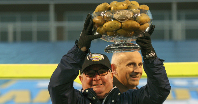 Dec 22, 2015; Boise, ID, USA; Akron Zips head coach Terry Bowden  holds The Famous Idaho Potato Bowl trophy at Bronco Stadium.  Akron defeated Utah State   23-21. Mandatory Credit: Brian Losness-USA TODAY Sports