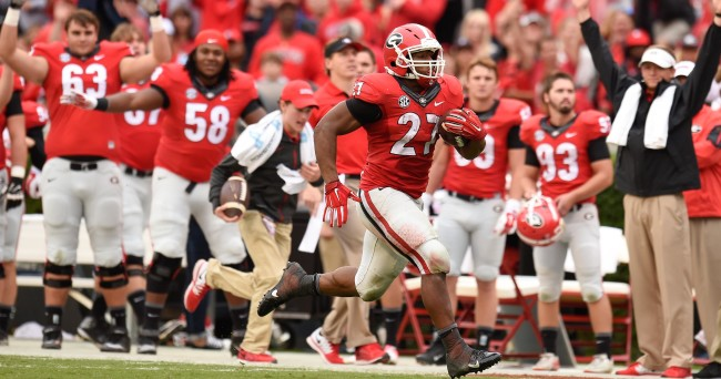 Sep 26, 2015; Athens, GA, USA; Georgia Bulldogs running back Nick Chubb (27) runs past the Georgia bench on his way to a touchdown against the Southern University Jaguars during the second half at Sanford Stadium. Georgia defeated Southern 48-6. Mandatory Credit: Dale Zanine-USA TODAY Sports