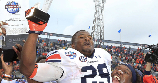 Dec 30, 2015; Birmingham, AL, USA; Auburn Tigers running back Jovon Robinson (29) is held up by  offensive lineman Avery Young (56) after he won the most valuable player trophy at his team defeated Memphis Tigers 31-10 in the 2015 Birmingham Bowl at Legion Field. Mandatory Credit: Marvin Gentry-USA TODAY Sports