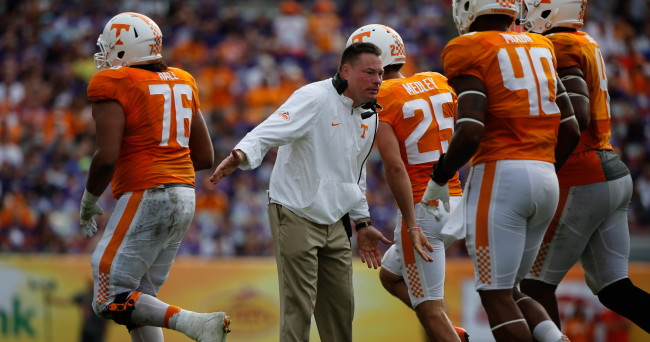 Jan 1, 2016; Tampa, FL, USA; Tennessee Volunteers head coach Butch Jones high fives teammates against the Northwestern Wildcats during the second half in the 2016 Outback Bowl at Raymond James Stadium. Tennessee Volunteers defeated the Northwestern Wildcats 45-6. Tennessee Volunteers Mandatory Credit: Kim Klement-USA TODAY Sports