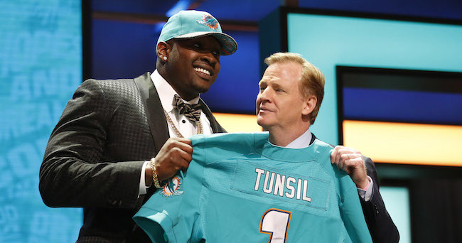 Apr 28, 2016; Chicago, IL, USA; Laremy Tunsil (Mississippi) with NFL commissioner Roger Goodell after being selected by the Miami Dolphins as the number thirteen overall pick in the first round of the 2016 NFL Draft at Auditorium Theatre. Mandatory Credit: Kamil Krzaczynski-USA TODAY Sports