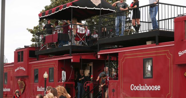 """Sep 27, 2014; Columbia, SC, USA;  South Carolina Gamecocks fans along with some ladies from Missouri enjoy pre game festivities at the """"Cockaboose's""""  located behind Williams-Brice Stadium. Missouri wins in the final minutes 21-20 over South Carolina. Mandatory Credit: Jim Dedmon-USA TODAY Sports"""