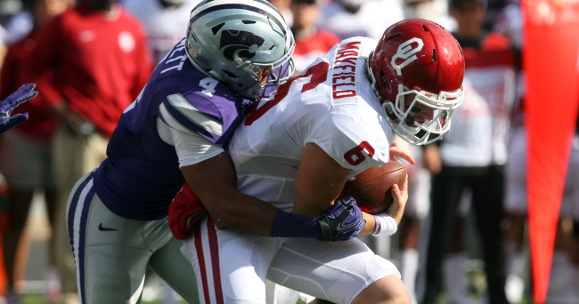 Oct 17, 2015; Manhattan, KS, USA; Oklahoma Sooners quarterback Baker Mayfield (6) is sacked by Kansas State Wildcats defensive back Kaleb Prewett (4) at Bill Snyder Family Football Stadium. Mandatory Credit: Scott Sewell-USA TODAY Sports