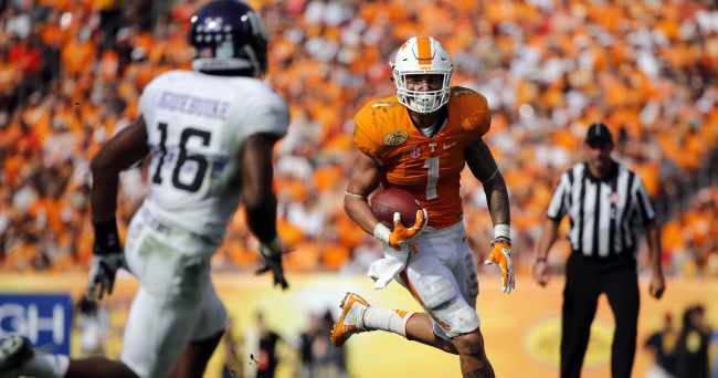 Jan 1, 2016; Tampa, FL, USA; Tennessee Volunteers running back Jalen Hurd (1) runs with the ball as Northwestern Wildcats safety Godwin Igwebuike (16) attempted to defend during the second half in the 2016 Outback Bowl at Raymond James Stadium. Tennessee Volunteers defeated the Northwestern Wildcats 45-6. Mandatory Credit: Kim Klement-USA TODAY Sports