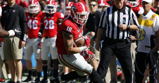 Apr 16, 2016; Athens, GA, USA; Georgia Bulldogs tight end Isaac Nauta (18) runs after a catch during the first half of the spring game at Sanford Stadium. Mandatory Credit: Brett Davis-USA TODAY Sports