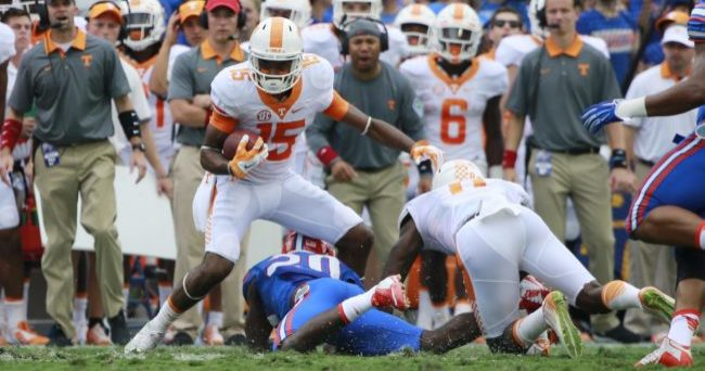 Sep 26, 2015; Gainesville, FL, USA; Tennessee Volunteers wide receiver Jauan Jennings (15) runs past Tennessee Volunteers linebacker Cortez McDowell (20)  during the first half at Ben Hill Griffin Stadium. Mandatory Credit: Kim Klement-USA TODAY Sports