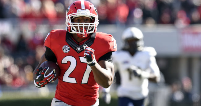 Nov 22, 2014; Athens, GA, USA; Georgia Bulldogs running back Nick Chubb (27) runs for a touchdown against the Charleston Southern Buccaneers during the first half at Sanford Stadium. Georgia defeated Charleston Southern 55-9. Mandatory Credit: Dale Zanine-USA TODAY Sports