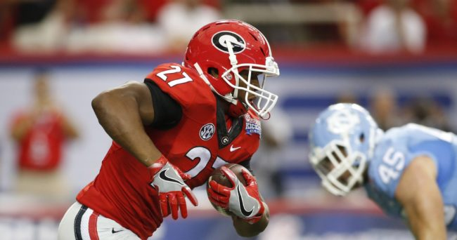 Sep 3, 2016; Atlanta, GA, USA; Georgia Bulldogs running back Nick Chubb (27) runs the ball against the North Carolina Tar Heels during the first quarter of the 2016 Chick-Fil-A Kickoff game at Georgia Dome. Mandatory Credit: Brett Davis-USA TODAY Sports