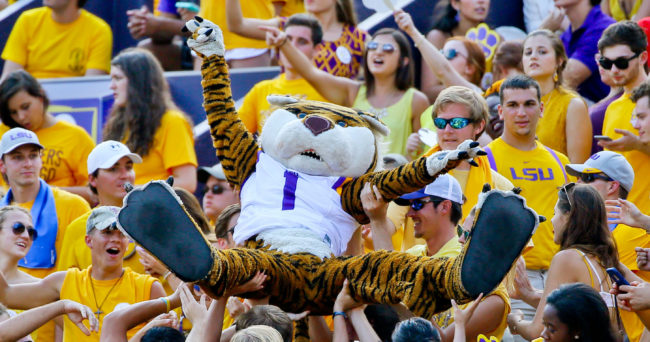 Sep 19, 2015; Baton Rouge, LA, USA; LSU Tigers mascot Mike the Tiger crowd surfs during the third quarter of a game against the Auburn Tigers at Tiger Stadium. Mandatory Credit: Derick E. Hingle-USA TODAY Sports