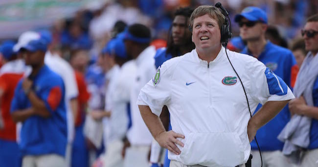 Sep 26, 2015; Gainesville, FL, USA; Florida Gators head coach Jim McElwain looks up against the Tennessee Volunteers during the first half at Ben Hill Griffin Stadium. Mandatory Credit: Kim Klement-USA TODAY Sports