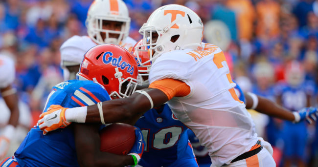 Sep 26, 2015; Gainesville, FL, USA; Tennessee Volunteers defensive back Micah Abernathy (3) tackles Florida Gators wide receiver Brandon Powell (4) during the second half at Ben Hill Griffin Stadium. Florida Gators defeated the Tennessee Volunteers 28-27. Mandatory Credit: Kim Klement-USA TODAY Sports
