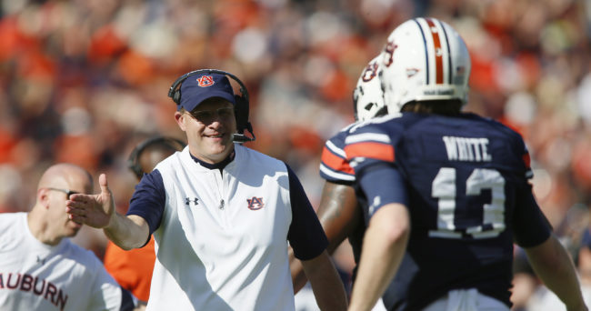 Oct 1, 2016; Auburn, AL, USA; Auburn Tigers head coach Gus Malzahn greets quarterback Sean White (13) after the Tigers scored a touchdown against the the UL-Monroe Warhawks during the second quarter at Jordan Hare Stadium. Mandatory Credit: John Reed-USA TODAY Sports