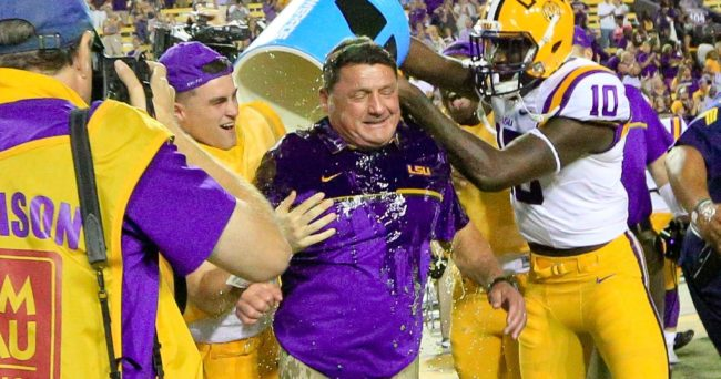 Oct 1, 2016; Baton Rouge, LA, USA;  LSU Tigers interim head coach Ed Orgeron is dunked with a cooler by quarterback Caleb Lewis (8) and wide receiver Stephen Sullivan (10) following a win in his first game against the Missouri Tigers at Tiger Stadium. LSU defeated Missouri 42-7. Mandatory Credit: Derick E. Hingle-USA TODAY Sports