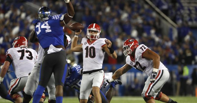 Nov 5, 2016; Lexington, KY, USA; Georgia Bulldogs quarterback Jacob Eason (10) passes the ball against Kentucky Wildcats defensive tackle Courtney Miggins (94) in the first half at Commonwealth Stadium. Mandatory Credit: Mark Zerof-USA TODAY Sports
