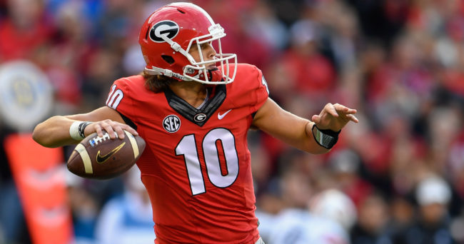 Nov 12, 2016; Athens, GA, USA; Georgia Bulldogs quarterback Jacob Eason (10) passes against the Auburn Tigers during the second quarter at Sanford Stadium. Georgia defeated Auburn 13-7. Mandatory Credit: Dale Zanine-USA TODAY Sports