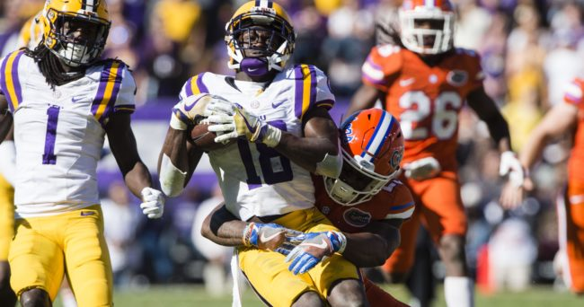Nov 19, 2016; Baton Rouge, LA, USA; LSU Tigers cornerback Tre'Davious White (18) is tackled by Florida Gators defensive back Chauncey Gardner (23) during the first half at Tiger Stadium. Mandatory Credit: Jerome Miron-USA TODAY Sports