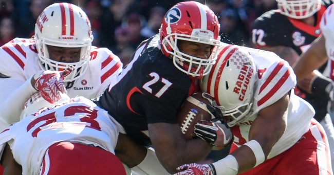 Nov 19, 2016; Athens, GA, USA; Georgia Bulldogs running back Nick Chubb (27) is tackled by Louisiana-Lafayette Ragin Cajuns defensive back Tracy Walker (23) and linebacker Tre'maine Lightfoot (4) during the second half at Sanford Stadium. Georgia defeated Louisiana-Lafayette 35-21. Mandatory Credit: Dale Zanine-USA TODAY Sports