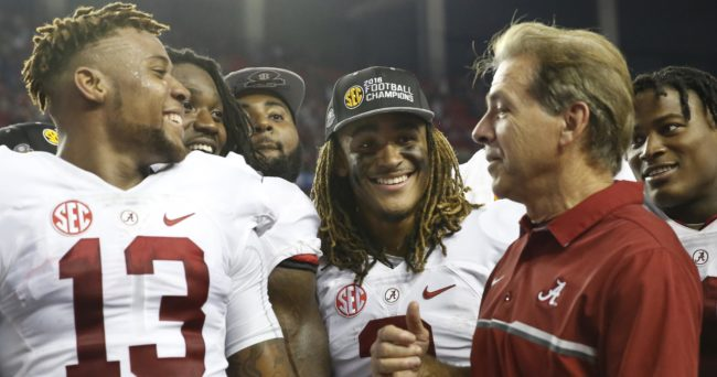 Dec 3, 2016; Atlanta, GA, USA; Alabama Crimson Tide quarterback Jalen Hurts (2) looks on during the trophy presentation with head coach Nick Saban and wide receiver ArDarius Stewart (13) after the SEC Championship college football game at Georgia Dome. Alabama defeated Florida 54-16. Mandatory Credit: Jason Getz-USA TODAY Sports
