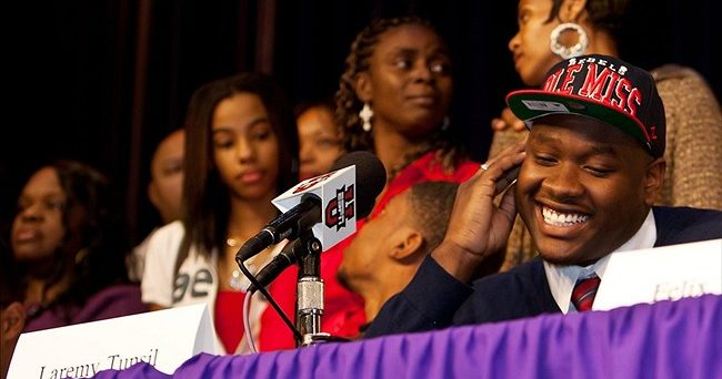 February 6, 2013; Lake City, FL, USA; Laremy Tunsil reacts after announcing that he will be attending the University of Mississippi on National Signing Day at Columbia High School. Mandatory Credit: Rob Foldy-USA TODAY Sports