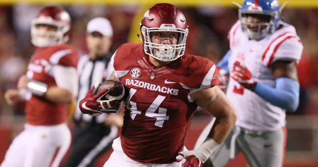 Oct 15, 2016; Fayetteville, AR, USA;  Arkansas Razorbacks tight end Austin Cantrell (44) runs after a catch in the fourth quarter against the Ole Miss Rebels at Donald W. Reynolds Razorback Stadium. Arkansas defeated Ole Miss 34-30. Mandatory Credit: Nelson Chenault-USA TODAY Sports