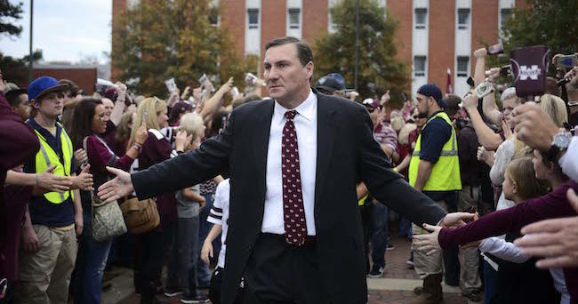 Nov 28, 2015; Starkville, MS, USA; Mississippi State Bulldogs head coach Dan Mullen greets fans at Dawg Walk before the game against the Mississippi Rebels at Davis Wade Stadium. Mandatory Credit: Matt Bush-USA TODAY Sports